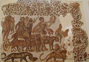 El triunfo de Dionisos, con una ménade que toca un tympanum, en un mosaico romano de Túnez (del siglo III a. C.)